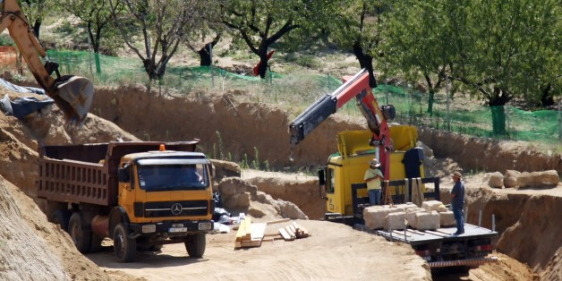 A photo taken on August 19, 2014 shows a crane putting aside the marbles of the entry of the site where archaeologists have unearthed a funeral mound dating from the time of Alexander the Great, in Amphipolis, Northern Greece. It is believed to be the largest ever discovered in Greece but archaeologists are stumped about who was buried in it. AFP PHOTO /SAKIS MITROLIDIS        (Photo credit should read SAKIS MITROLIDIS/AFP/Getty Images)