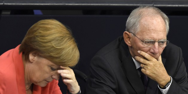 German Chancellor Angela Merkel (L) confer with finance minister Wolfgang Schaeuble during a debate in the  Bundestag, the German lower house of parliament in Berlin on July 17, 2015. German lawmakers will vote during todays sitting in the Bundestag on entering into negotiations on the new aid package for Greece.   AFP PHOTO / TOBIAS SCHWARZ        (Photo credit should read TOBIAS SCHWARZ/AFP/Getty Images)