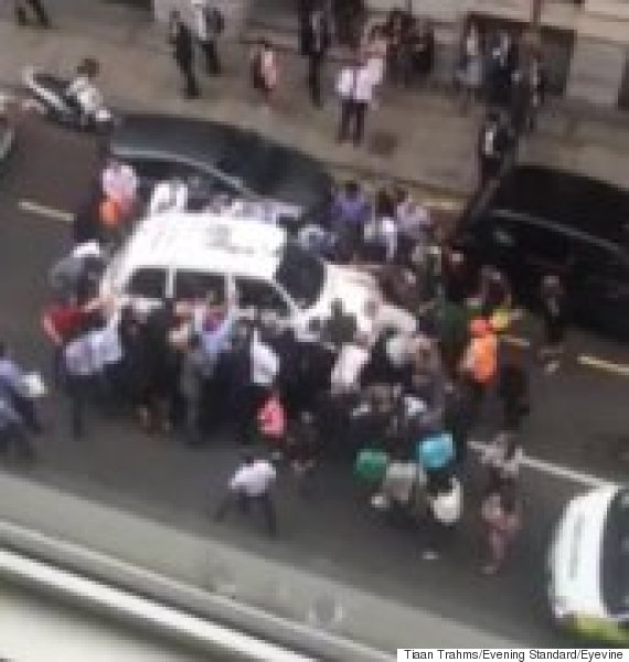 londoners lift cab off woman