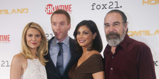 "Cast members, from left, Claire Danes, Damian Lewis, Morena Baccarin, and Mandy Patinkin arrive at the private premiere screening for the 3rd Season of ""Homeland"" at Corcoran Gallery of Art on Monday, Sept. 9, 2013 in Washington. (Photo by Kevin Wolf/Invision/AP)"