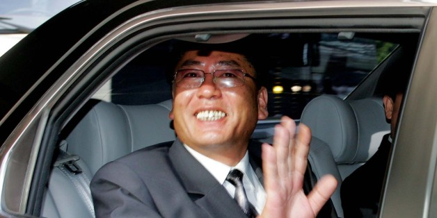 The head of North Korean delegation, Choe Yong-gon, deputy minister of construction and building material industries, waves  as he leaves  to North Korea after the inter-Korean economic talks in Seoul Tuesday,  July 12, 2005.  South Korea agreed Tuesday to provide North Korea with 500,000 tons in rice aid as the countries vowed to boost economic ties after the North announced it would end its boycott of nuclear disarmament talks.  (AP Photo /You Sung-Ho, POOL)