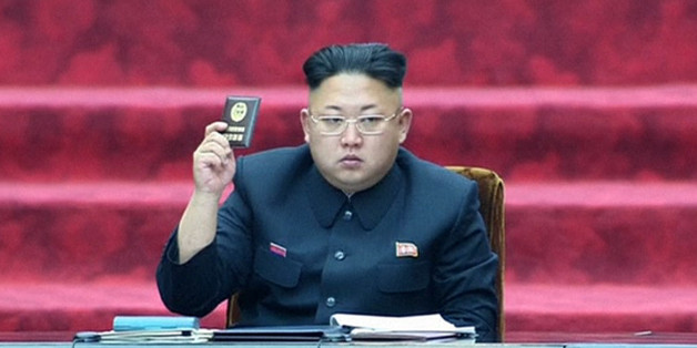 """In this Wednesday, April 9, 2014 image made from video, North Korean leader Kim Jong Un holds up a parliament membership certificate during the Supreme People's Assembly in Pyongyang, North Korea. North Korea is declaring that the upcoming release of """"The Interview,"""" a comedy film about a plot to assassinate Kim Jong Un, would be an act of war. From over-the-top villainous roles in films such as """"Olympus Has Fallen"""" and """"Die Another Day"""" to madcap impersonations in series like """"30 Rock"""" and """"MAD"""