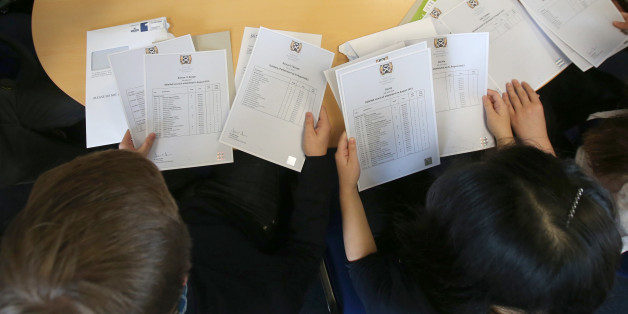 Pupils from Craigmount High School in Edinburgh open their Scottish Higher exam results.