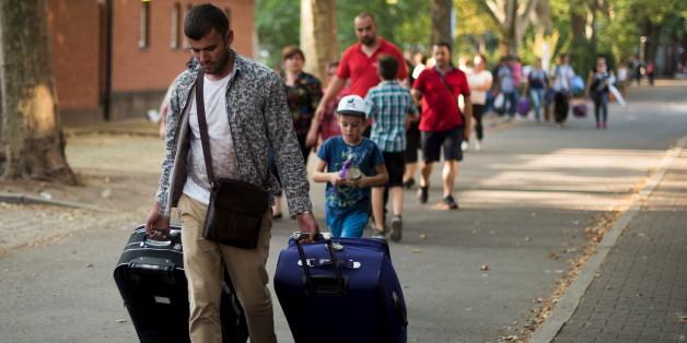 Des migrants à Berlin en toute pour demander l'asile, le 10 août 2015.