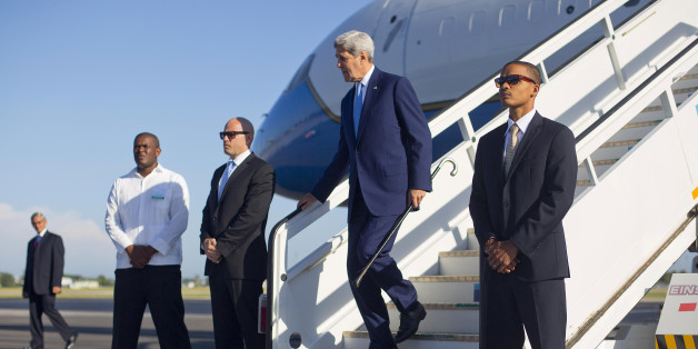 Secretary of State John Kerry arrives at Jose Marti International Airport in Havana, Cuba, Friday, Aug. 14, 2015. Kerry traveled to the Cuban capital to raise the U.S. flag and formally reopen the long-closed U.S. Embassy. Cuba and U.S. officially restored diplomatic relations July 20, as part of efforts to normalize ties between the former Cold War foes. (AP Photo/Pablo Martinez Monsivais,Pool)