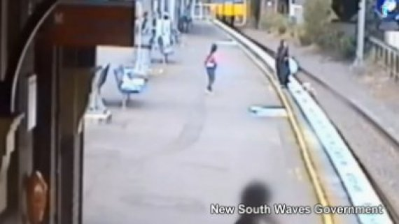woman pulled from tracks