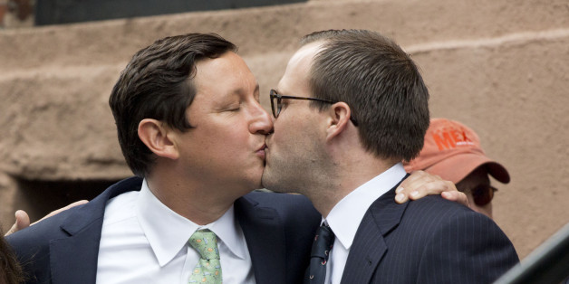 David Turley, center, and Peter Thiede, kiss before getting married, Sunday, June 28, 2015 in front of New York's Stonewall Inn. Friday the U.S. Supreme Court legalized gay marriage across the 50 states. (AP Photo/Mark Lennihan)