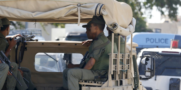Tunisian army patrol near the attacked Imperial Marhaba hotel in Sousse, Tunisia, Saturday, June 27, 2015. The morning after a lone gunman killed dozens of people at a beach resort in Tunisia, busloads of tourists are heading to the nearby Enfidha-Hammamet airport hoping to return to their home countries. (AP Photo/Darko Vojinovic)