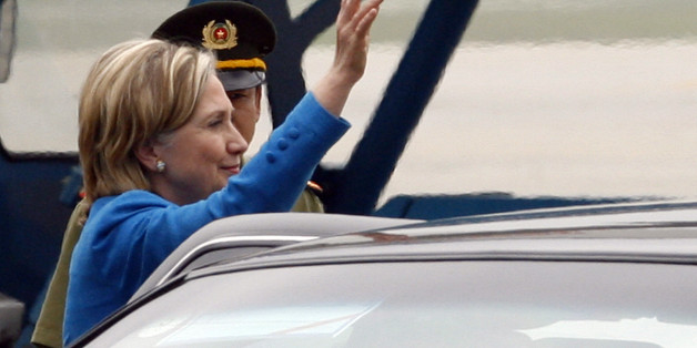 U.S. Secretary of State Hilary Clinton waves her hand to the media upon her arrival at the airport in Hanoi, Vietnam Thursday, July 22, 2010. (AP Photo/Kham, Pool)