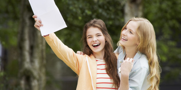 Two Teenage Girls Celebrating Successful Exam Results Smiling