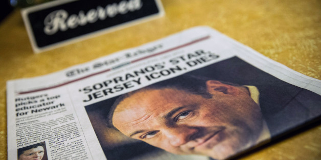 BLOOMFIELD, NJ - JUNE 20:  Flowers and a copy of the Newark Star-Ledger sit at the booth where the final scene of the final episode of the HBO show, 'The Sopranos,' was filmed, at Holsten's restaurant on June 20, 2013 in Bloomfield, New Jersey. 'Sopranos' star James Gandolfini, who played the troubled mob boss Tony Soprano, died at age 51 yesterday in Rome.  (Photo by Andrew Burton/Getty Images)