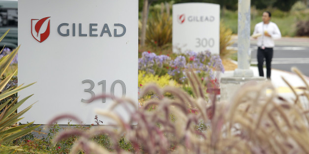 FILE - In this July 9, 2015 file photo, a man walks outside the headquarters of Gilead Sciences in Foster City, Calif. Gilead Sciences reports quarterly financial results on Tuesday, July 28, 2015. (AP Photo/Eric Risberg, File)