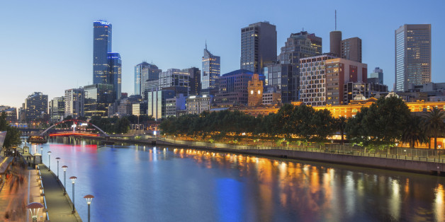 The lights of Melbourne City reflect in the Yarra river at night