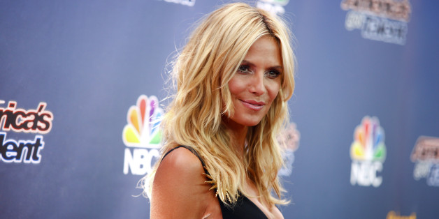 """Heidi Klum arrives at """"America's Got Talent"""" season 10 live voting rounds red carpet at Radio City Music Hall on Tuesday, Aug. 11, 2015, in New York. (Photo by Andy Kropa/Invision/AP)"""