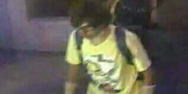 This Aug. 17, 2015, image, released by Royal Thai Police spokesman Lt. Gen. Prawut Thavornsiri shows a man wearing a yellow T-shirt near the Erawan Shrine before an explosion occurred in Bangkok, Thailand.Prawut said he believes the man is a suspect in the blast that killed a number of people at a shrine in downtown Bangkok on Monday night. (Royal Thai Police via AP)