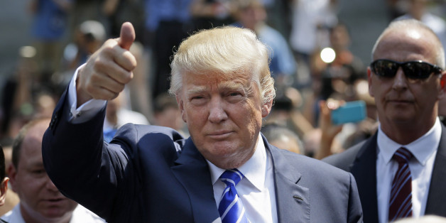 Donald Trump gives a thumbs-up as he leaves for lunch after being summoned for jury duty in New York, Monday, Aug. 17, 2015. Trump was due to report for jury duty Monday in Manhattan. The front-runner said last week before a rally in New Hampshire that he would willingly take a break from the campaign trail to answer the summons. (AP Photo/Seth Wenig)