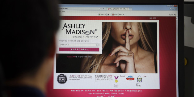 FILE - In this June 10, 2015 photo, Ashley Madison's Korean web site is shown on a computer screen in Seoul, South Korea. Avid Life Media Inc., the parent company of Ashley Madison, a matchmaking website for cheating spouses, said it was hacked and that the personal information of some of its users was posted online. The breach was first reported late Sunday, July 19, 2015, by Brian Krebs of Krebs on Security, a website that focuses on cybersecurity. (AP Photo/Lee Jin-man, File)