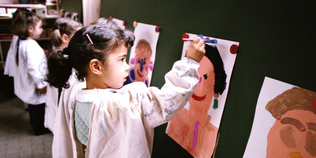 SMALL CHILDREN IN CLASSROOM PAINTING PORTRAITS