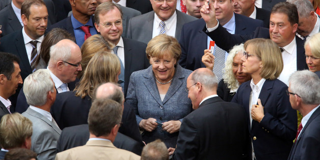 BERLIN, GERMANY - AUGUST 19:  German Chancellor Angela Merkel (CDU) casts her vote on a third bailout package for economically-troubled Eurozone member Greece as she attends a meeting of the German federal parliament, or Bundestag, on August 19, 2015 in Berlin, Germany. European governments vote on the issue this week. Merkel and the country's finance minister, Wolfgang Schaeuble, have encouraged German parliamentarians to support the latest plan, evaluated at 86 billion euros (USD 95.5 billion). Meanwhile the leaders praised the Greek government for accepting German prerequisites for the offer, and have assured that the International Monetary Fund (IMF) would participate in the latest bailout package.  (Photo by Adam Berry/Getty Images)
