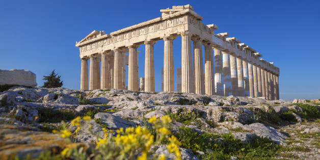 Famous Parthenon temple with spring flowers on the  Acropolis in Athens, Greece