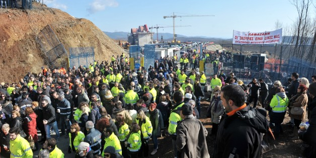 Gold mine workers protest against Greek new leftist government's plan to scrap a gold mine project in the Halkidiki peninsula, northern Greece, outside their mine in Skouries on February 15, 2015. Greece's new leftist government will scrap a controversial gold mine project that has sparked protests in northern Greece, the environment minister said on February 10.  Violent resistance has broken out since permission to break ground on the project was granted in 2011 to Hellenic Gold, a Greek subsi