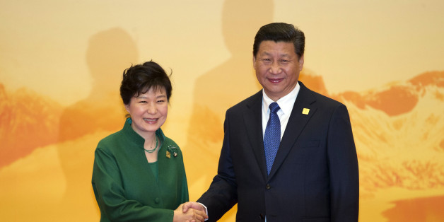 South Korean President Park Geun-hye shakes hands with Chinese President Xi Jinping during a welcome ceremony for the Asia-Pacific Economic Cooperation (APEC) Economic Leaders Meeting held at the International Convention Center in Yanqi Lake, Beijing, on Tuesday, Nov 11, 2014. (AP Photo/Ng Han Guan)