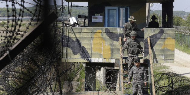 South Korean army soldiers step down from a military post guard near the demilitarized zone between the two Koreas in Paju, South Korea, Sunday, May 10 , 2015. North Korea said Saturday that it successfully test-fired a newly developed ballistic missile from a submarine in what would be the latest display of the country's advancing military capabilities. Hours after the announcement, South Korean officials said the North fired three anti-ship cruise missiles into the sea off its east coast.(AP Photo/Ahn Young-joon)