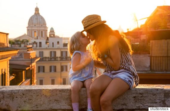 parents kiss children