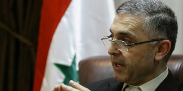 Le ministre syrien de la Réconciliation, Ali Haïdar, lors d'une interview à Damas le 11 février 2014