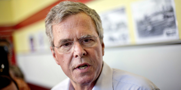 Republican presidential candidate, former Florida Gov. Jeb Bush talks to reporters at The Varsity restaurant during a campaign stop Tuesday, Aug. 18, 2015, in Atlanta. (AP Photo/David Goldman)