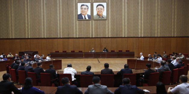 "North Korea's General Reconnaissance Bureau Director Kim Yong Chol, center left, sits under the portraits of the late North Korean leaders, Kim Il Sung, left, and Kim Jong Il, as he speaks during a briefing for foreign diplomats regarding the latest situation at the border between the two Koreas at the People's Cultural House in Pyongyang, North Korea, Friday, Aug. 21, 2015. North Korean leader Kim Jong Un on Friday declared his frontline troops in a ""quasi-state of war"" and ordered them to prep"