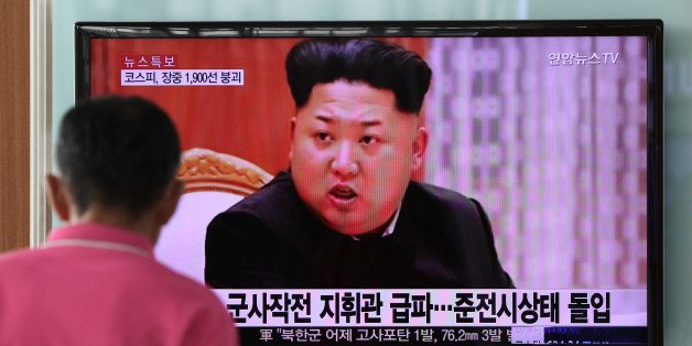 A man looks at a television screen showing an image of Kim Jong Un, leader of North Korea, during a news broadcast on North Korea's exchange of fire with South Korea at Seoul Station in Seoul, South Korea, on Friday, Aug. 21, 2015. North Korean leader Kim Jong Un ordered his army to prepare for war after an exchange of fire with South Korea, ratcheting up the rhetoric as the latest skirmish between the two nations intensifies. Photographer: SeongJoon Cho/Bloomberg via Getty Images