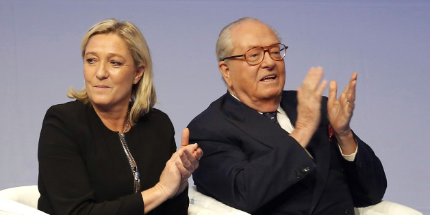 FILE - In this Saturday Nov. 29, 2014 file photo, French far-right Front National leader Marine Le Pen and her father Jean-Marie Le Pen applaud in Lyon, central France. A French court has reinstated Thursday July 2, 2015 Jean-Marie Le Pen as a member of the far right National Front party he founded decades ago, sending a biting blow to his daughter and party president Marine Le Pen, who had suspended him after a series of controversial and anti-Semitic statements. (AP Photo/Laurent Cipriani, Fil