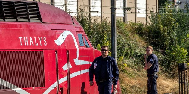 A French police officer walks along the platform next to a Thalys train of French national railway operator SNCF at the main train station in Arras, northern France, on August 22, 2015, the day after an armed gunman on the train was overpowered by passengers. The gunman opened fire on the train travelling from Amsterdam to Paris, injuring two people before being tackled by several passengers including off-duty American servicemen.  .  AFP PHOTO PHILIPPE HUGUEN        (Photo credit should read PHILIPPE HUGUEN/AFP/Getty Images)