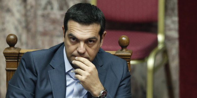 Greek Prime Minister Alexis Tsipras listens during a parliamentary session in Athens, Friday, Aug. 14, 2015. Greek lawmakers are continuing a debate in parliament to approve a massive new bailout deal after repeated delays over procedure and dissent within the governing left-wing Syriza party caused the session to last through the night. (AP Photo/Yannis Liakos)
