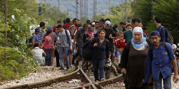 Migrants arrive at the railway station in the southern Macedonia's town of Gevgelija, after breaking through the police blockade on the border with Greece, on Saturday, Aug. 22, 2015. About 39,000 people, mostly Syrian migrants, have been registered as passing through Macedonia in the past month, twice as many as the month before. They previously encountered little resistance at the border, but the recent influx has overwhelmed Macedonian authorities who this week declared a state of emergency and stopped many from crossing. (AP Photo/Boris Grdanoski)