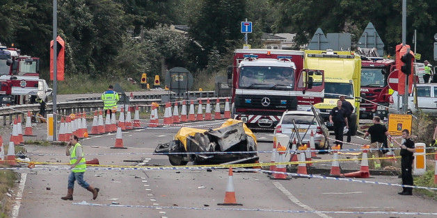 Emergency services attend the scene on the A27 as seven people have died after a plane crashed into cars on the major road during an aerial display at the Shoreham Airshow in West Sussex.