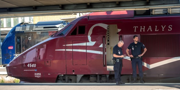 French police stand guard along the platform next to a Thalys train of French national railway operator SNCF at the main train station in Arras, northern France, on August 22, 2015, the day after an armed gunman on the train was overpowered by passengers. The gunman opened fire on the train travelling from Amsterdam to Paris, injuring two people before being tackled by several passengers including off-duty American servicemen.  AFP PHOTO PHILIPPE HUGUEN        (Photo credit should read PHILIPPE HUGUEN/AFP/Getty Images)