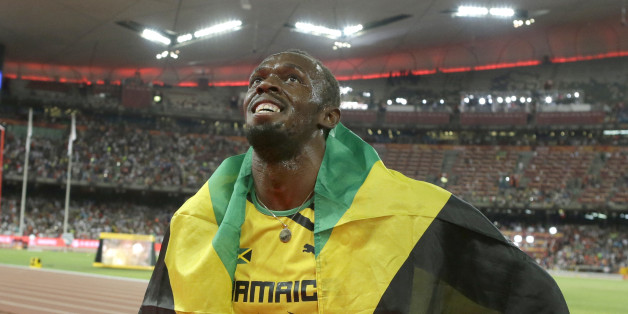 Jamaica's Usain Bolt celebrates after winning the gold medal in the men's 100m ahead of United States' at the World Athletics Championships at the Bird's Nest stadium in Beijing, Sunday, Aug. 23, 2015. (AP Photo/Lee Jin-man)