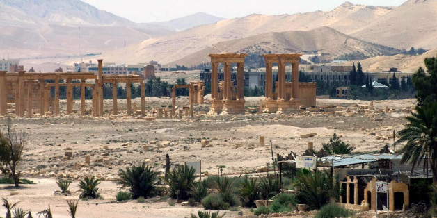 FILE - This file photo released on Sunday, May 17, 2015, by the Syrian official news agency SANA, shows the general view of the ancient Roman city of Palmyra, northeast of Damascus, Syria. Activists say Islamic State militants have destroyed a temple at Syria's ancient ruins of Palmyra. News that the militants blew up the Baalshamin Temple came after the extremists beheaded Palmyra scholar Khaled al-Asaad on Tuesday, hanging his bloodied body from a pole in the town's main square. (SANA via AP, File)