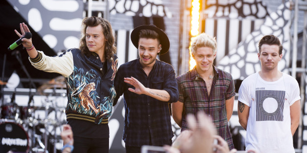 """One Direction members, from left, Harry Styles, Liam Payne, Niall Horan and Louis Tomlinson perform on ABC's """"Good Morning America"""" at Rumsey Playfield/SummerStage on Tuesday, Aug. 4, 2015, in New York. (Photo by Charles Sykes/Invision/AP)"""