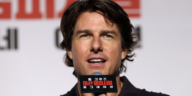 """Actor Tom Cruise speaks during a press conference for his new movie """"Mission: Impossible - Rogue Nation"""" in Seoul, South Korea, Thursday, July 30, 2015. The movie is released in South Korea on July 30. (AP Photo/Lee Jin-man)"""