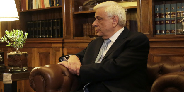 Greek Prime Minister Alexis Tsipras , left, speaks with  Greek President Prokopis Pavlopoulos, during their meeting in Athens, Thursday, Aug. 20, 2015. Tsipras announced his government's resignation and called early elections Thursday, seeking to consolidate his mandate to implement a new three-year international bailout that sparked a rebellion within his radical left Syriza party. (AP Photo/Petros Giannakouris)