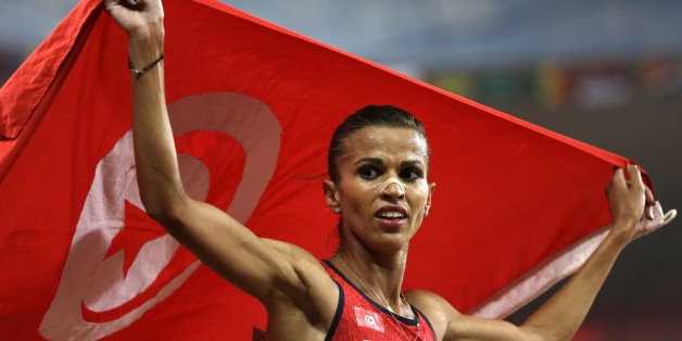 Tunisia's Habiba Ghribi celebrates after finishing second in the women's 3000m steeplechase final at the World Athletics Championships at the Bird's Nest stadium in Beijing, Wednesday, Aug. 26, 2015. (AP Photo/David J. Phillip)