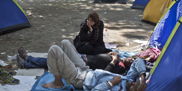 Migrants from Syria rest at a park in Belgrade, Serbia, Wednesday, Aug. 26, 2015. Thousands of migrants, including many women with babies and small children, have crossed into Serbia over the past few days and are heading toward Hungary and the E.U.  (AP Photo/Marko Drobnjakovic)