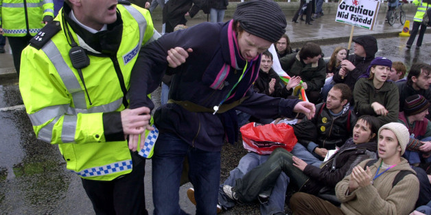 Matthew Walsh, 21, a student studying fine art at Pembroke College, Oxford, is pulled away by a police officer during a sit-in by some students on Waterloo Bridge in central London.  *Thousands of students from across the UK descended upon London to begin a march through the capital to protest against the idea of top-up fees for students.