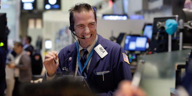 Trader Gregory Rowe works on the floor of the New York Stock Exchange, Wednesday, Aug. 26, 2015. U.S. stocks closed sharply higher, giving the stock market its best day in close to four years. The Dow Jones industrial average climbed 619 points, or 4 percent on Wednesday. (AP Photo/Richard Drew)
