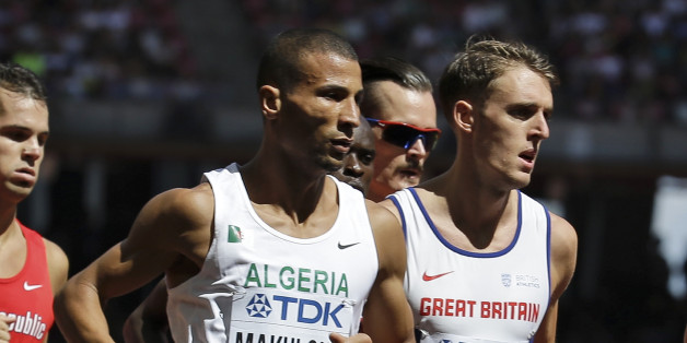 Algeria's Taoufik Makhloufi and Britain's Charlie Grice compete in a round one heat of the men's 1500m at the World Athletics Championships at the Bird's Nest stadium in Beijing, Thursday, Aug. 27, 2015. (AP Photo/David J. Phillip)