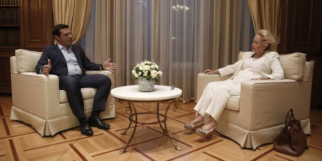 Outgoing Prime Minister Alexis Tsipras, left, speaks with Greece's new Prime Minister Vassiliki Thanou, during a handover ceremony in Athens, Thursday, Aug. 27, 2015. Greece came one step closer on Thursday to early elections with President Prokopis Pavlopoulos appointing the head of the country's Supreme Court Vassiliki Thanou as caretaker prime minister to lead the country to next month's polls. (AP Photo/Petros Giannakouris)