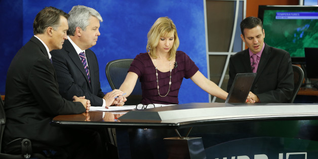 WDBJ-TV7 news morning anchor Kimberly McBroom, second from right, and meteorologist Leo Hirsbrunner, right, are joined by visiting anchor Steve Grant, second from left, and Dr. Thomas Milam, of the Carilion Clinic, as they observe a moment of silence during the early morning newscast at the station, in Roanoke, Va., Thursday, Aug. 27, 2015. The moment of silence was at the moment reporter Alison Parker and cameraman Adam Ward were killed during a live broadcast Wednesday, while on assignment in